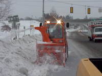 A new sidewalk plow removes snow for pedestrians on Main Street